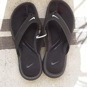 Black Nike flip flop